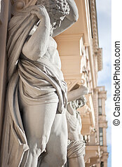 Neoclassical atlantes at the entrance to a house near Vienna's parliament