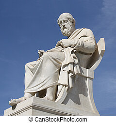 Neoclassical statue of ancient Greek philosopher, Plato, in front of the Academy of Athens in Greece.