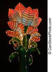 Casino's illuminated neon colored flower decoration in the night