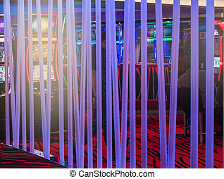 Neon glowing tubes in the interior of the casino, dark background
