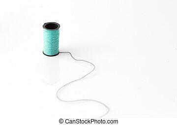 neon green color thread loom standing on black thread over white bakcground