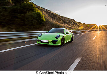 Neon green sport cabriolet on the highway
