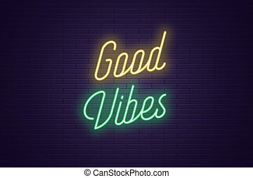 Neon lettering of Good Vibes. Glowing text