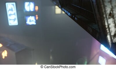 neon lights in soft focus on street with fog at night