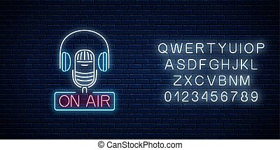 Neon on the air sign with microphone and headphones with...