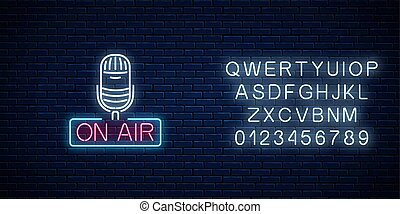 Neon on the air sign with microphone with alphabet. Glowing...