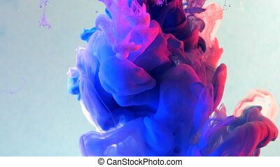 Neon purple, pink and white ink underwater. Mixed paints...