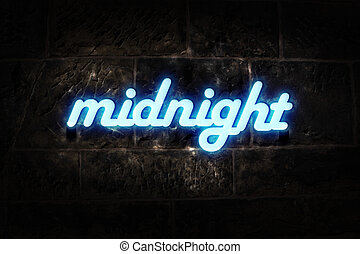 """Blue neon sign on a brick wall with message """"midnight""""."""