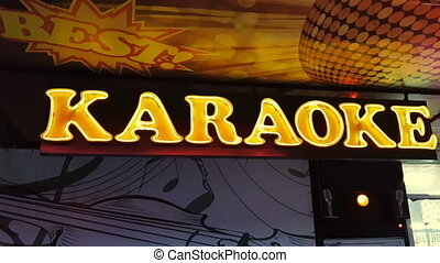 Neon sign of karaoke at the entrance to the night club