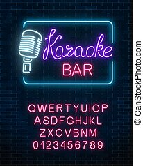 Neon signboard of karaoke music bar with alphabet. Glowing...