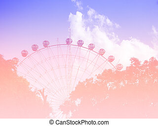 neon tinted. Ferris wheel on the background of blue sky