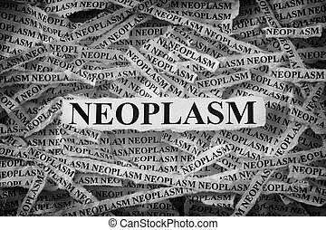 Torn pieces of paper with the word Neoplasm