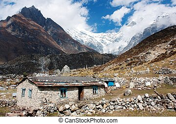 Nepalese building in Langtang valley and Langtang peak