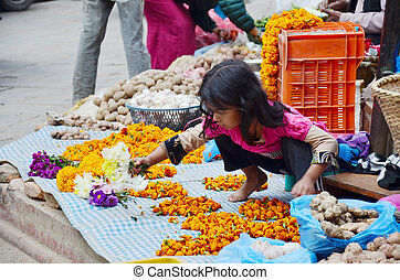 Nepalese people make Garland for sale at Thamel market on...