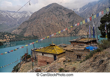 Picturesque old settlement by scenic lake in Dolpo region in Nepal