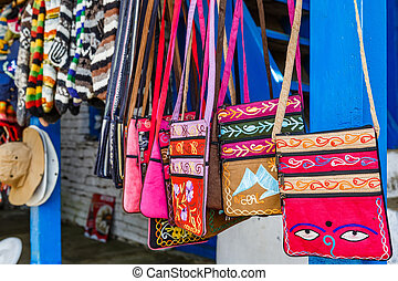 Nepalese souvenir shop - Photo of colorful small bags in...