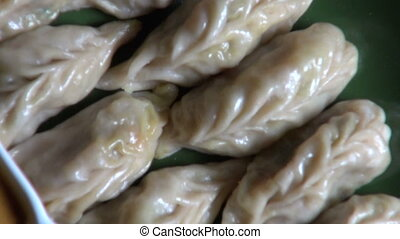 Nepalese traditional dumpling momos served with tomato...