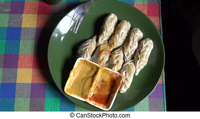 Nepalese traditional dumpling momos served with tomato ...
