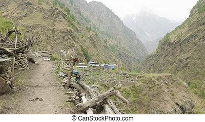 Nepalese village between the mountains. Manaslu circuit trek...
