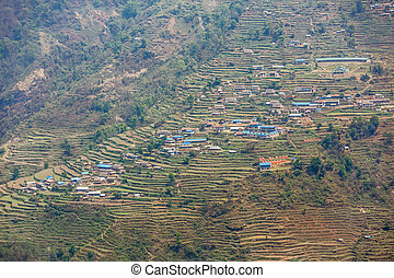 Nepalese village in the mountainside - Landscape photo of...