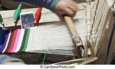 Nepalese woman weaves woolen scarf. - Nepalese woman weaves ...