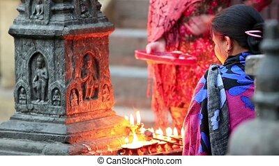 Nepalese women at the main entrance - KATHMANDU, NEPAL -...
