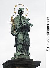 Nepomuk statue at St. Charles Bridge in Prague, Europe.