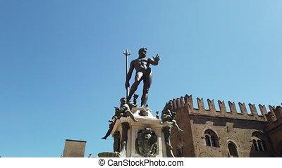 Neptune 1500s bronze statue fountain with gothic architecture background in Piazza Maggiore central square of Bologna town in Italy.