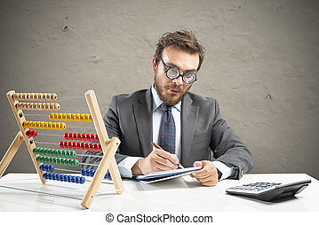 Nerd accountant does calculation of company revenue