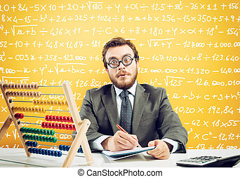 Nerd accountant does calculation of company revenue on yellow background