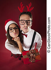Nerd couple blowing kisses in christmas time
