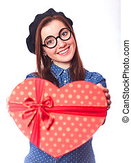 Nerd girl in glasses with heart shape gift.
