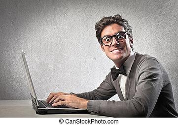 Nerd guy with laptop