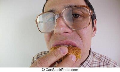 Nerd man eats a cake - Funny nerd has a lunch