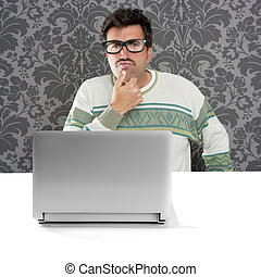 Nerd pensive man glasses silly expression laptop