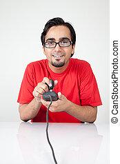 Nerd playing retro game, holding joystick