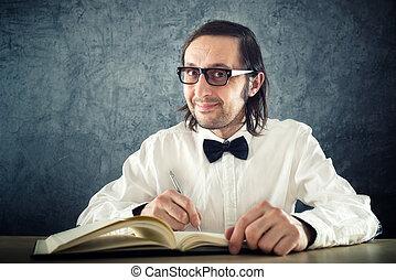 Nerd poet writing poems, sitting at work desk.