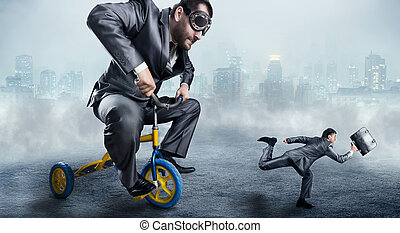 Nerdy businessman riding a small bicycle