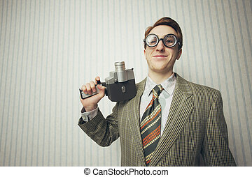 Nerdy businessman with old fashioned cine camera