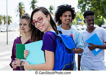 Nerdy female student group of international students
