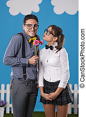 Nerdy man giving his girlfriend couple flowers