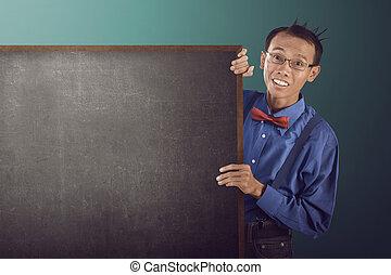 Nerdy man holding blank board