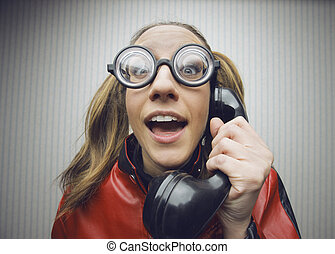 Nerdy woman speaking on a black rotary vintage phone