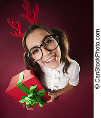 Nerdy woman with horns and christmas gift