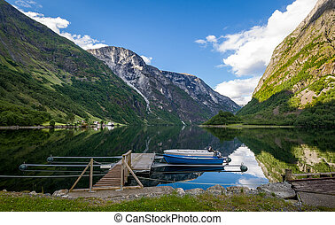Neroy fjord landscape with small wooden boats.