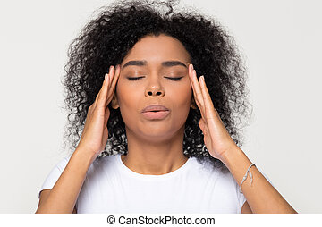 Nervous african woman breathing calming down trying to relieve stress