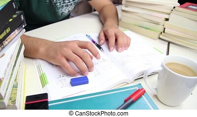 Nervous student fingers tapping on table