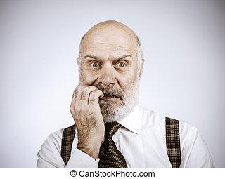 Nervous anxious senior man biting his nails