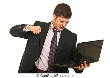 Nervous business man fist  laptop