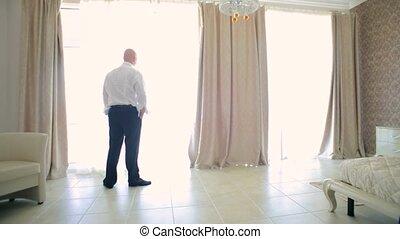 Nervous Man Walking In Room